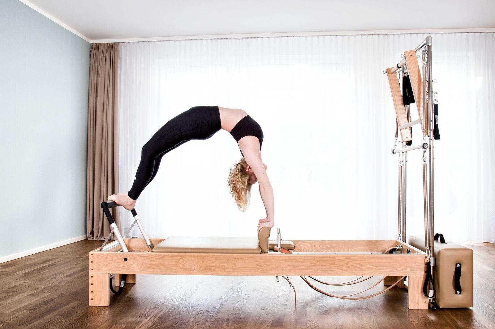 High Bridge am Reformer klassische Pilates Übung mit Gina Mathis Pilates Studio München